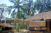 Well maintained 1.50 acre land with 2 houses for sale in Payyampally